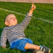 Little boy pointing up at the sky — Stock Photo