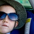 Little boy wearing Mums sunglasses - Stock Photo