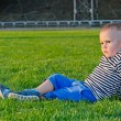 Little boy relaxing with his soccer ball — Stock Photo
