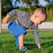 Cute little boy on a soccer field — Stock Photo #19777123