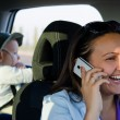 Royalty-Free Stock Photo: Woman driver laughing on her mobile phone