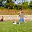 Athletic small boy playing soccer — Stock Photo #19777133