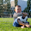 Laughing little boy with his soccer ball — Stock Photo