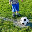 Little child about to kick off - Stock Photo