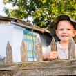 Stock Photo: Beaming little boy in summer sunhat