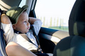 Little boy in a child safety seat — Stockfoto