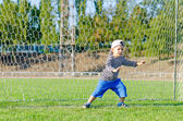 Small boy stretching to save a goal — Stock Photo