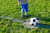 Little child about to kick off — Stock Photo