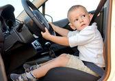 Little boy pretending to drive — Stock Photo