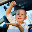 Little boy playiing with car keys - Stock Photo