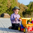 Cute little boy with a toy truck — Stock Photo