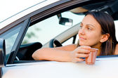 Woman waiting patiently in her car — Stock Photo