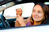 Woman enjoying coffee in her car — Stock Photo