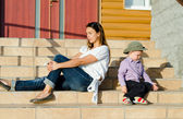 Mother and son sitting in the sun — Stock Photo