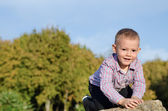 Happy little boy exploring outdoors — Stock Photo