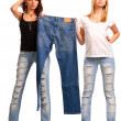 Stock Photo: Trendy girls holding up outmoded denim jeans