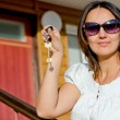 Woman holding a house door key — Stock Photo