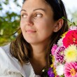 Thoughtful woman with beautiful flowers — Foto de Stock