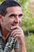 Smiling pensive man — Stock Photo