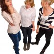 Three attractive women standing chatting — Stock Photo #20425455