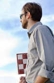 Man holding a chessboard — Stock Photo