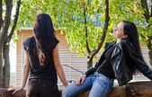 Two women chatting outdoors — Stock Photo
