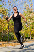 Young woman out jogging — Stock Photo