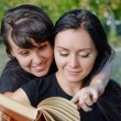 Friends sharing a book — Stock Photo