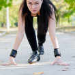 Woman in the starting position for a run — Stock Photo