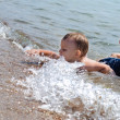 Little boy splashing in the sea — Stock Photo