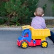 Little boy playing with a colourful truck — Stock Photo