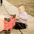 Small boy playing with a plastic truck — Stock Photo