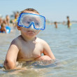 Small boy wearing goggles at the seaside — Stock Photo #22184387