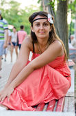 Brunette in a red sundress — Stock Photo