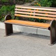Empty wooden park bench — Stock Photo