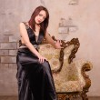 Young woman sitting on the arm of a fancy chair — Stock Photo #23734405