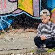 Stock Photo: Small boy sitting thinking or sulking