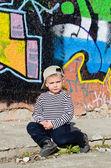Small boy sitting thinking — Stock Photo