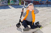 Bashful little boy covering his eyes — Stock Photo