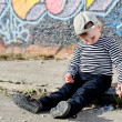 Stock Photo: Lonely little boy sitting on sidewalk