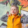 Cute little boy pulling a face pursing his lips — Stock Photo #24368009