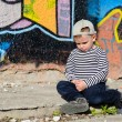 Little boy sitting sulking — Stock Photo