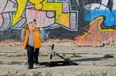 Cute little boy playing in front of graffiti — Stock Photo