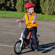 Happy confident little boy on his bike — Stock Photo