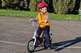 Happy confident little boy on his bike — Stock Photo