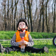 Cute little boy taking a break from riding — Stock Photo