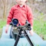 Rifle barrel and child — Stock Photo #25592735