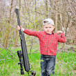 Stock Photo: Cute little boy holding big rifle