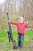 Cute little boy holding a big rifle — Stock Photo