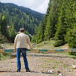 Man admiring a forested valley — Stock Photo